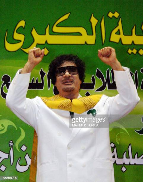 Libyan leader Moamer Kadhafi gestures during a ceremony marking the anniversary of the 1976 Student Revolution in Sirte 600 kms east of Tripoli on...