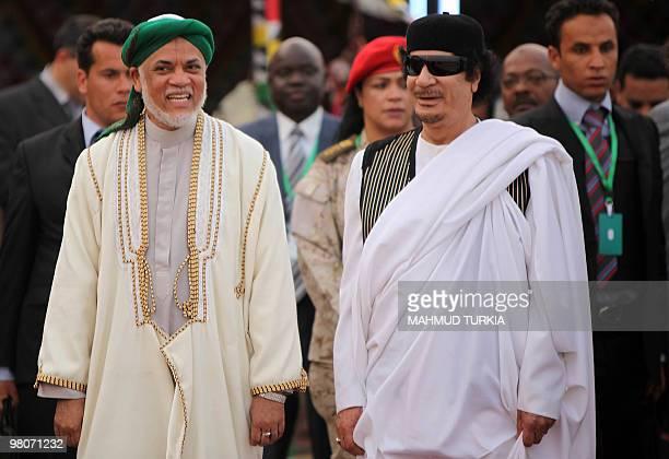 Libyan leader Moamer Kadhafi greets Comoros' President Ahmed Abdallah Sambi upon his arrival at the airport in the Libyan coastal city of Sirte on...