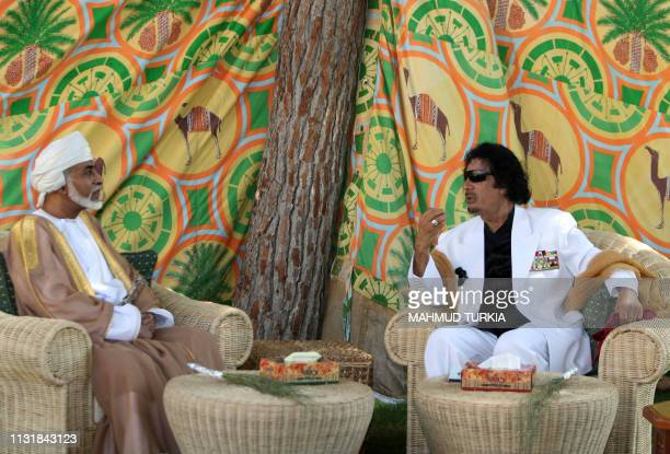 Libyan leader Moamer Kadhafi meets with Omani Sultan Qaboos bin Said upon the latter's arrival at Tripoli on August 11 2008 Sultan Qaboos arrived...