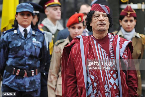 Libyan leader Moamer Kadhafi with his suite review an honour guard during a welcoming ceremony at the presidential office in Kiev on November 4 2008...