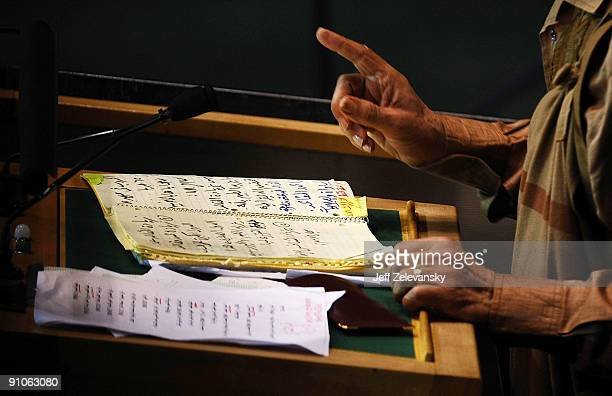 Libyan leader Moammar Gadhafi gestures over his notes as he addresses at the 64th General Assembly at United Nations Headquarters on September 23...