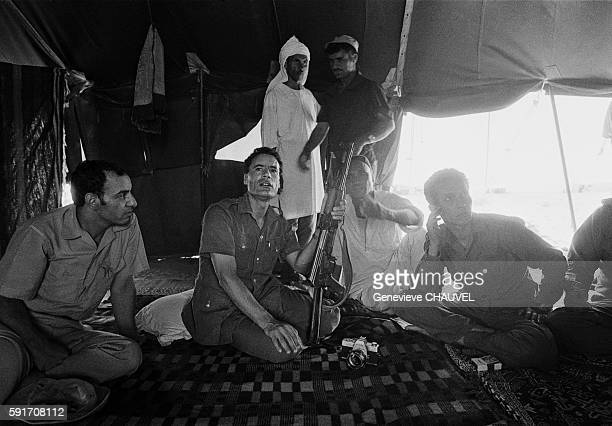 Libyan Leader Muammar alQaddafi and followers in a tent in the Syrtes Desert Libya