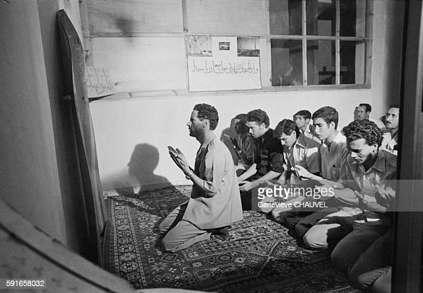 Libyan Leader Muammar alQaddafi meets with Libyan high school students who are studying abroad in Tripoli Libya