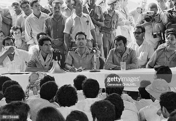 Libyan Leader Muammar alQaddafi meets with Libyan students who are studying abroad in Tripoli Libya Accompanied by Commander Abdul Salam Jalloud and...