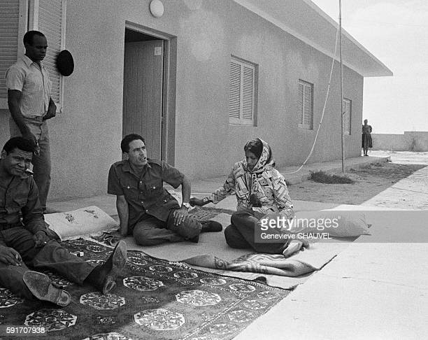 Libyan Leader Muammar alQaddafi relaxes at a fortified house in the Syrtes Desert Libya