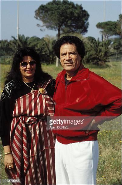 Libyan leader Muammar Gaddafi poses with wife Safia in the military barracks of Bab alAzizia on March 18 1992 in Tripoli Libya