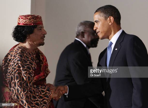 Libyan leader Muammar Gaddafi shakes hands with U.S. President Barack Obama during the G8 summit on July 9, 2009 in L'Aquila, Italy. The talks are...