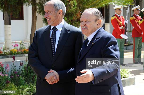 Libyan leader Mustafa Abdel Jalil head of the National Transitional Council shakes hands with Algerian President Abdelaziz Bouteflika at AlMouradia...