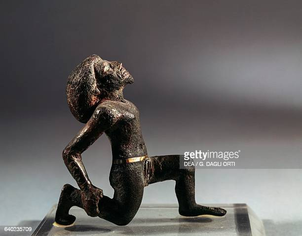 Libyan male figure kneeling bronze with silver encrustations Egyptian civilisation New Kingdom Dynasty XIX Paris Musée Du Louvre