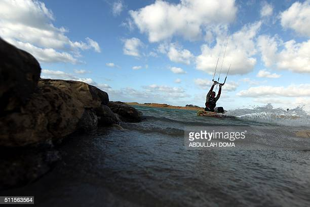 Libyan man practices kite boarding in the eastern city of Benghazi on February 21 2016 / AFP / ABDULLAH DOMA
