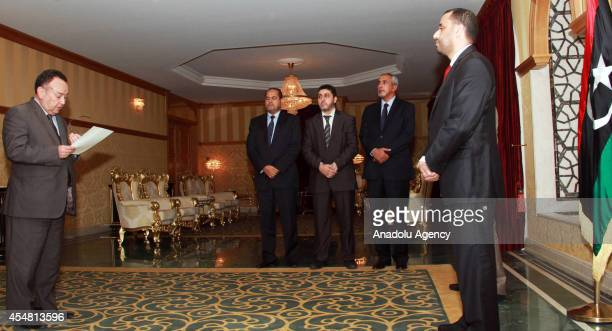 Libyan Minister of Foreign Affairs Mohamed Agheirani swears his oath in front of Saleh alMakzom the deputy president of the General National Congress...