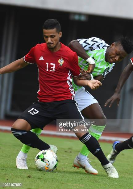 Libyan Mohammad Abdulsalam vies for the ball with Nigerian Samuel Kalu during the African Cup of Nations qualification match between Nigeria and...