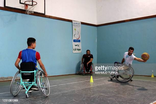 Libyan Mohsen Hassan bin Daou , victim of a gunshot wound that has left him paralysed during Libya's 2011 revolution, takes part in a wheelchair...