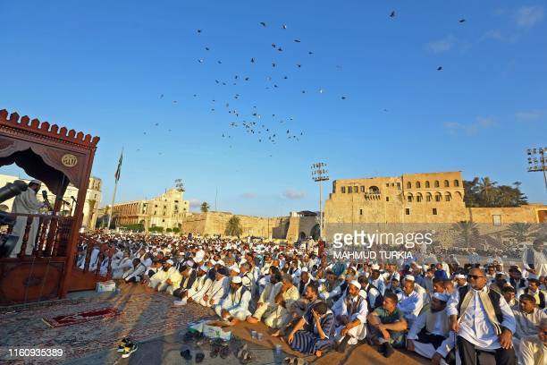 TOPSHOT Libyan Muslims perform the Eid AlAdha morning prayer at the Martyrs Square of the capital Tripoli on August 11 2019 Muslims across the world...
