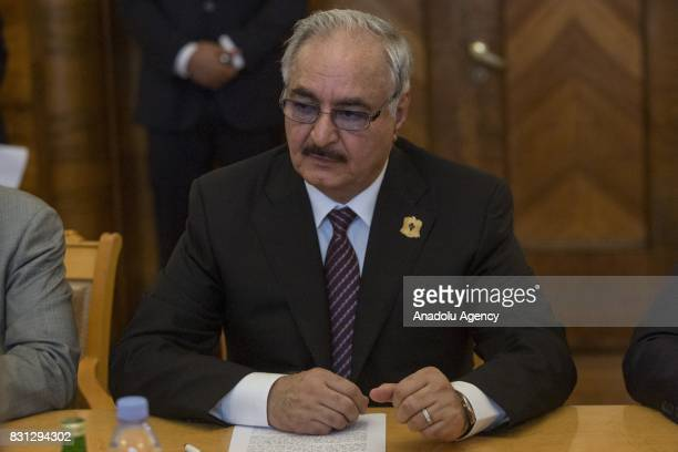 Libyan National Army Commander Khalifa Haftar speaks with Russian Foreign Minister Sergei Lavrov during their meeting in Moscow Russia on August 14...