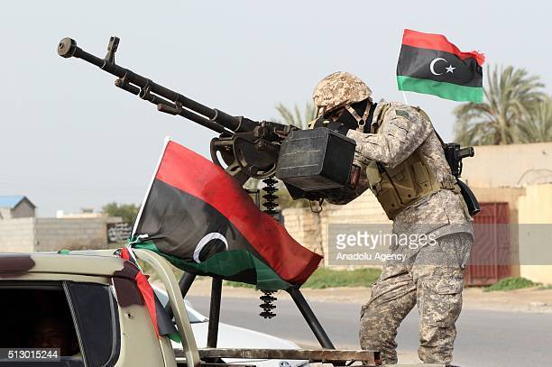Libyan national security forces stage a show of strength after clashes against Daesh in the town of Sabratha Libya on February 28 2016