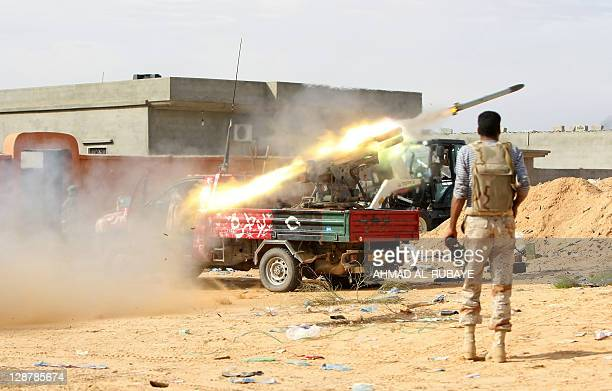 Libyan National Transitional Council fighters fire a rocket during a street battle in Sirte on October 7 2011 Sirte was rocked by deadly street...