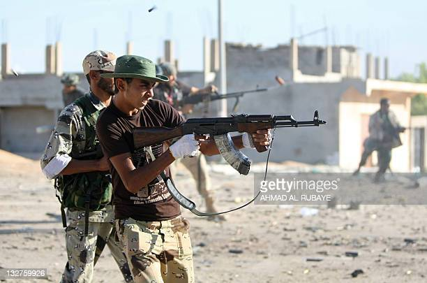 Libyan National Transitional Council fighters fire at loyalist forces in central Sirte on October 16 2011 Fighters of Libya's new regime launched a...