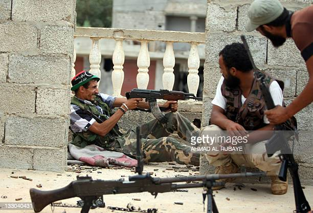 Libyan National Transitional Council fighters take position during a street battle in Sirte on October 7 2011 Sirte was rocked by deadly street...