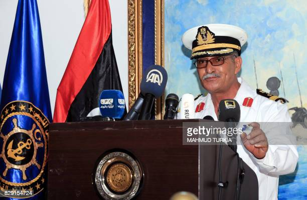 Libyan navy spokesman Ayoub Qassem gives a press conference at the Tripoli naval base in the capital on August 10 as the Libyan navy ordered foreign...