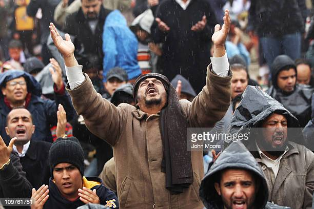 Libyan opposition supporters pray in the rain March 4 2011 in Benghazi Libya Thousands of protesters gathered for Friday prayers and listened to a...