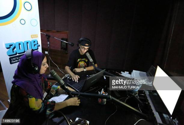 Libyan presenters work at the studio of Radio Zone one of the hippest channels to hit the airwaves since the ouster of Moamer Kadhafi on August 5...