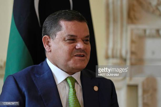 Libyan Prime Minister Abdul Hamid Dbeibeh talks with Britain's Prime Minister Boris Johnson at the start of their meeting inside 10 Downing Street in...