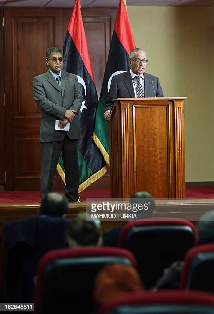 Libyan prime minister Ali Zaidan and Libya's Interior Minister Ashour Shuail give a joint press conference on February 28 2013 in Tripoli Libya's...