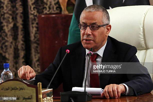 Libyan Prime Minister Ali Zeidan speaks during a press conference in Tripoli on October 30 during which he announced the reopening of the Marsa...