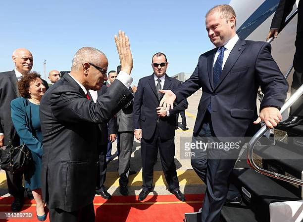 Libyan Prime Minister Ali Zeidan welcomes his Maltese counterpart Joseph Muscat following the latter's arrival in Tripoli on October 13 2013 to...