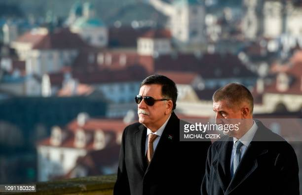 Libyan Prime Minister Fayez al-Sarraj and Czech Prime Minister Andrej Babis review a guard of honour ahead their meeting on January 30, 2019 in...