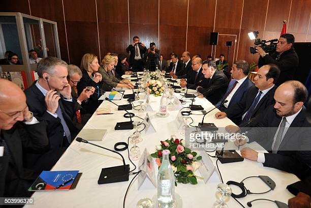Libyan Prime Minister Fayez alSarraj and EU foreign policy chief Federica Mogherini attend the talks between EU and Libya delegations in Tunis on...