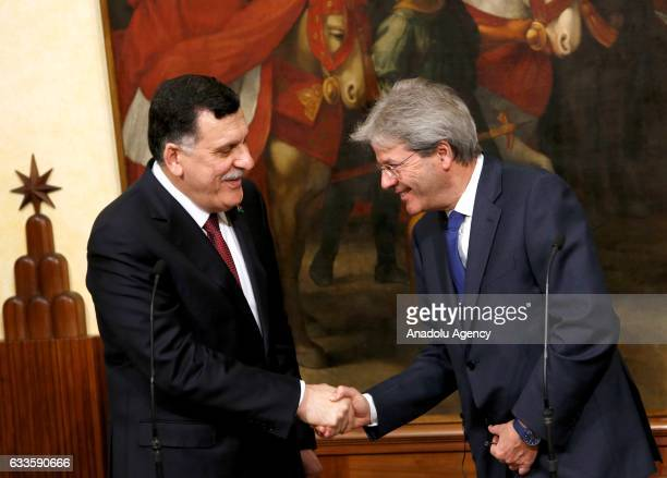 Libyan Prime Minister Fayez al-Sarraj and Italian Prime Minister Paolo Gentiloni shake hands after signing a bilateral agreement on the fight against...
