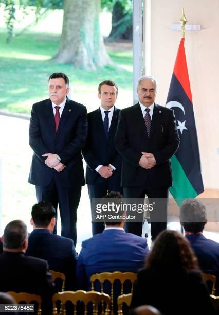 Libyan Prime Minister Fayez alSarraj French President Emmanuel Macron and General Khalifa Haftar commander in the Libyan National Army attend a press...
