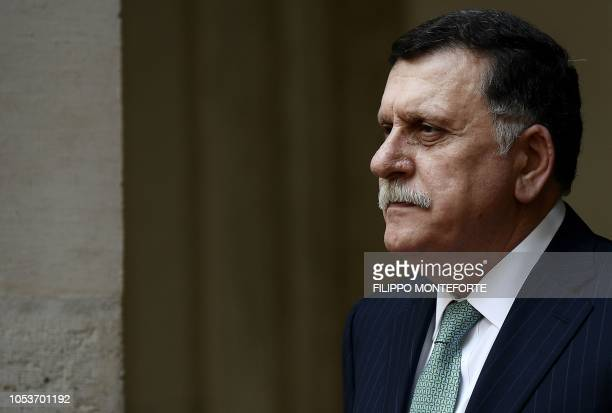 Libyan Prime Minister Fayez al-Sarraj looks on before a meeting with his Italian counterpart Giuseppe Conte at the Palazzo Chigi in Rome on October...
