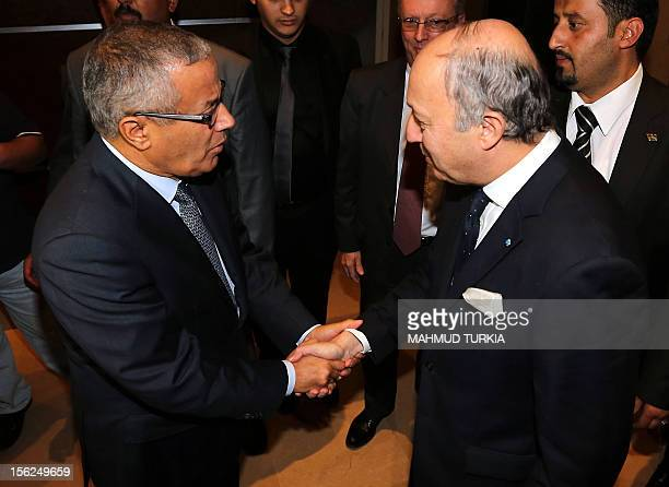 Libyan prime minister-designate Ali Zeidan shakes hands with French Foreign Minister Laurent Fabius during a meeting in Tripoli on November 12, 2012...