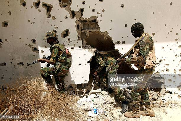 Libyan progovernment forces patrol a rural area on the outskirts of the eastern coastal city of Benghazi which they retook from armed groups as...