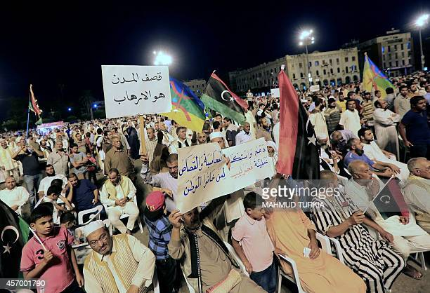 Libyan protesters take part in a rally calling for the removal of Libya's internationally recognised parliament which is based in the eastern city if...