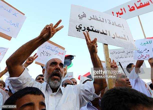 Libyan protestors take part in a rally in Tripoli's central Martyr's Square on September 19 2014 in support of 'Fajr Libya' a mainlyIslamist alliance...