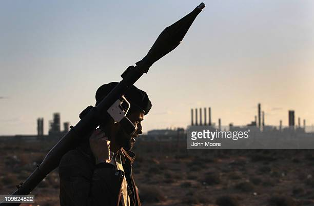 Libyan rebel carries a rocket propelled grenade near strategic petroleum facilities on March 7 2011 in Ras Lanuf Libya Opposition forces remained in...