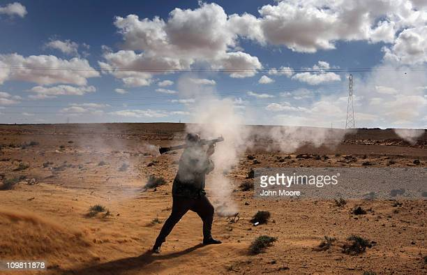 Libyan rebel fires a rocket propelled grenade at government troops on the frontline on March 6, 2011 near Ben Jawat, Libya. Rebels lost territory as...