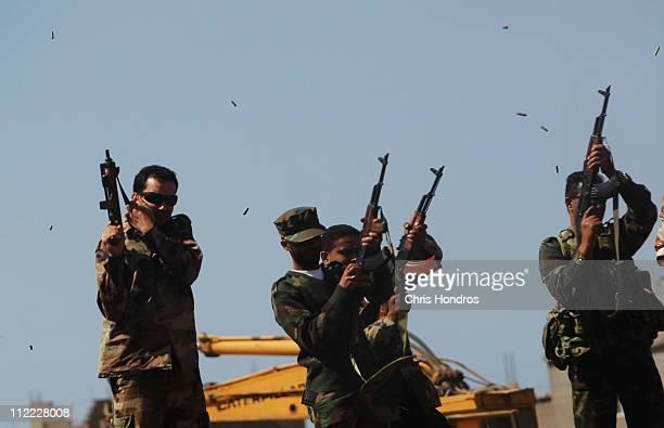 Libyan rebel honor guard fires into the air during the burial of Ramadan Omar Balah April 15, 2011 in Benghazi, Libya. Balah, a rebel against...