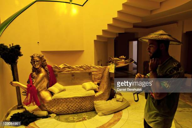 Libyan rebel soldier walks through the house of Aisha Gaddafi the daughter of Libyan leader Muammar Gaddafi on August 30 2011 in Tripoli Libya Libyan...