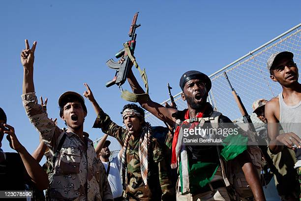 Libyan rebel soldiers from Bengazi celebrate as they arrive on an exLibyan Army frigate on August 30 2011 in Tripoli Libya The arrival of the...