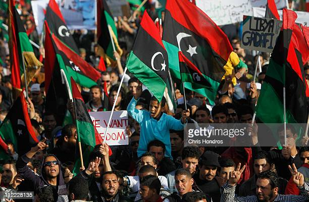 Libyan rebel supporters march while demanding the end of longtime Libyan ruler Moammar Gaddafi's rule April 15, 2011 in Benghazi, Libya. Thousands of...