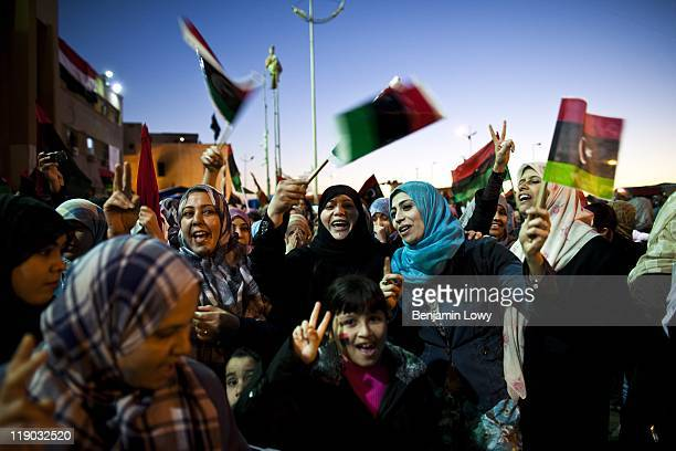 Libyan rebels and Bengazi residents celebrate the passing of a UN resolution calling for a no-fly-zone over Libyan airspace, and their belief of...