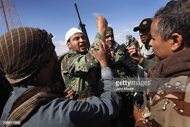 Libyan rebels argue on the frontline while battling government troops on the frontline on March 6, 2011 near Ben Jawat, Libya. Rebels lost territory...