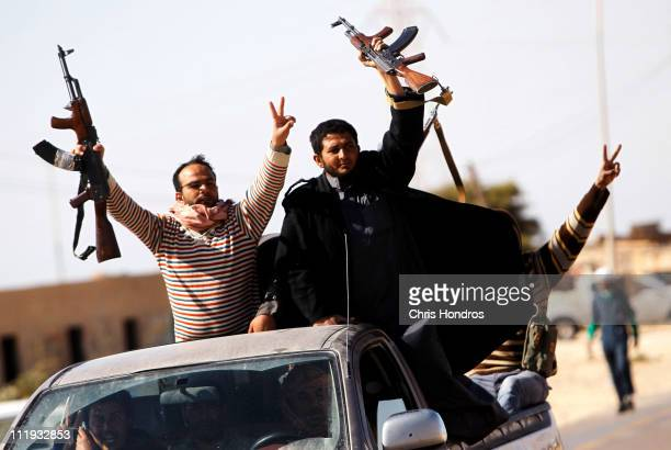 Libyan rebels cheer as they advance in a truck April 9 2011 outside of Ajdabiyah Libya Rebels continued their battles with Libyan loyalist soldiers...