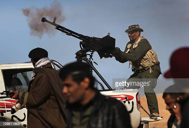 Libyan rebels fire on government forces on the frontline on March 6, 2011 near Ben Jawat, Libya. Rebels lost territory as troops loyal to Libyan...