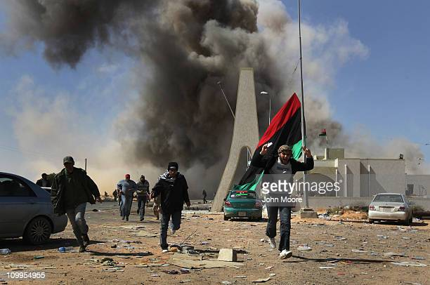 Libyan rebels flee a government airstrike on the frontline on March 11 2011 in Ras Lanuf Libya Government troops loyal to Libyan leader Moammar...